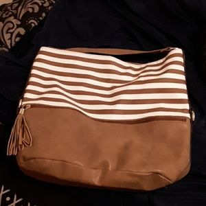 Huge tan and white vinyl purse